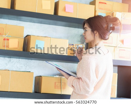 Young business woman working online shopping at her home