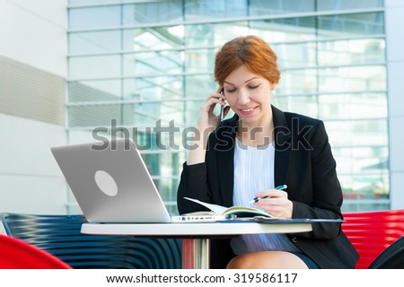 Young business woman working portrait