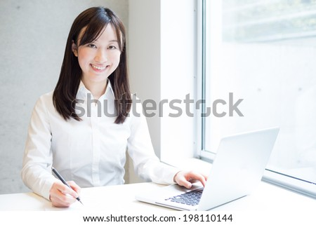 Young business woman working with laptop computer at the office