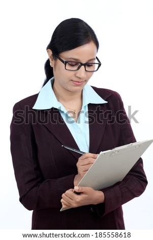 Young business woman working with stylus and digital tablet pc - stock photo
