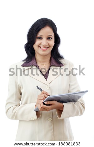 Young business woman working with tablet against white