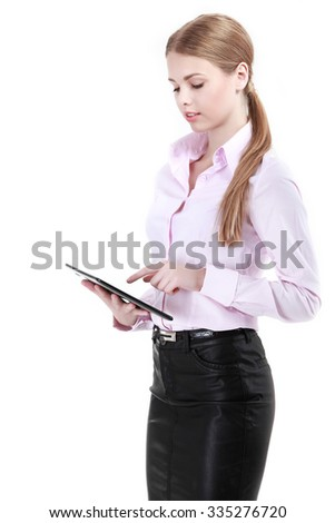 Young business woman working with tablet pc