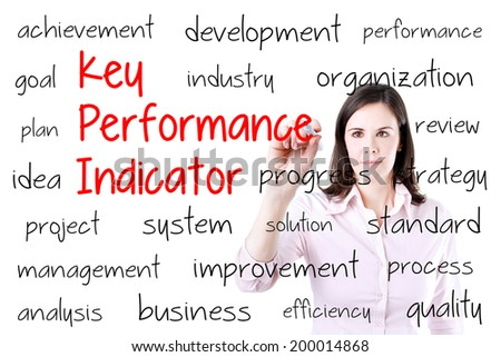 Young business woman writing key performance indicator (kpi) concept. Isolated on white.  - stock photo