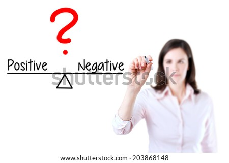 Young business woman writing positive and negative compare on balance bar. Isolated on white background. - stock photo