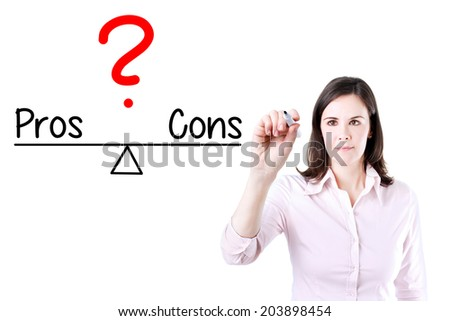 Young business woman writing pros and cons compare on balance bar. Isolated on white. - stock photo