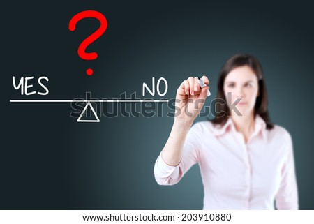 Young business woman writing yes and no compare on balance bar. Blue background. - stock photo