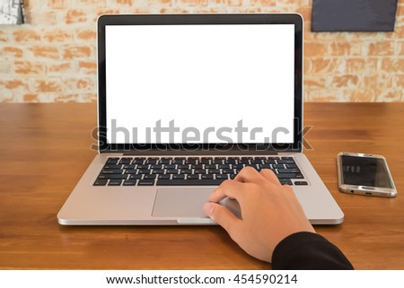 Young business women hand using laptop computer and smartphone in home office with blank screen - stock photo