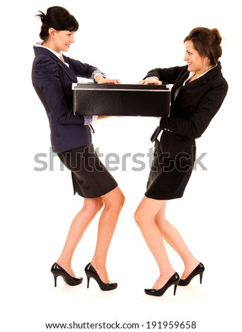 young business women pulling the big black box, full lenght, white background - stock photo