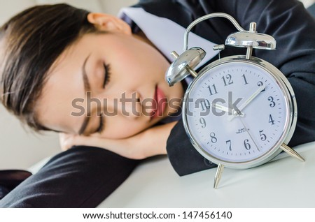 Young business women sleeping in office - stock photo