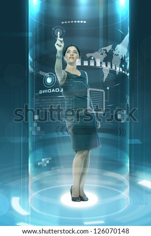 young businesslady working on futuristic virtual screen - stock photo