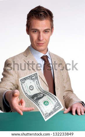 Young businessman agent giving one dollar bill.