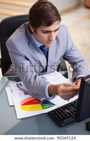 Young businessman analyzing statistics