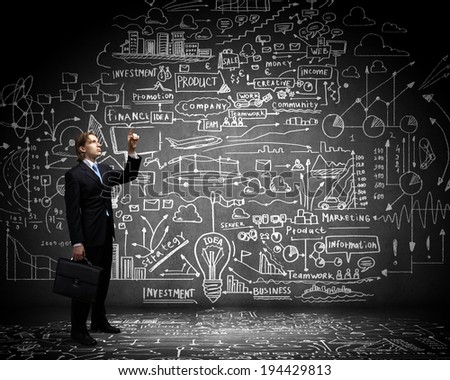 Young businessman and big light bulb against sketch background