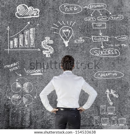 young businessman and business plan - stock photo