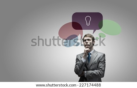Young businessman and colorful thoughts above her head - stock photo
