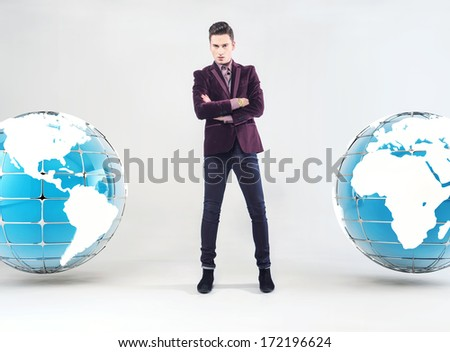 Young businessman and Earth globe