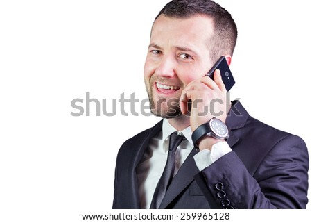 Young Businessman and handsome look speaking on the mobil phone. Amazing look. Isolated on white - stock photo