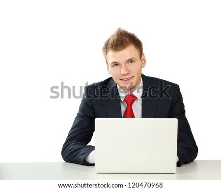 Young businessman at his workplace, isolated on white background - stock photo