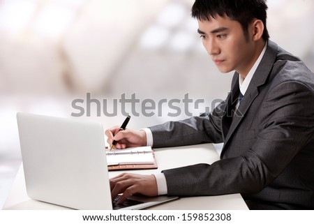 Young businessman at office - stock photo