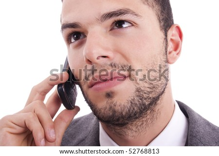 young businessman at the mobile phone, isolated on white
