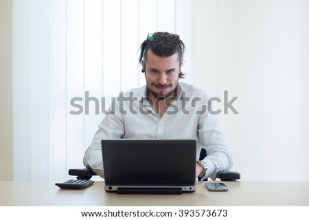 young businessman at work with laptop, worn-out