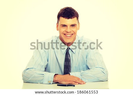 Young businessman behind the desk