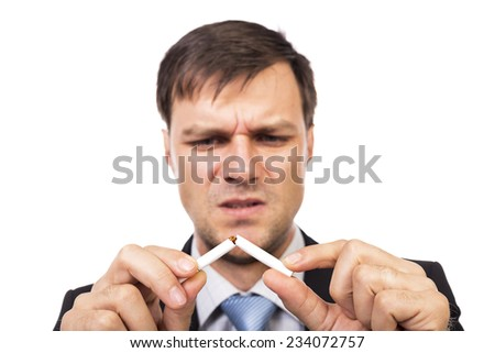 Young businessman breaking a cigarette, concept for give up smoking, isolated over white background
