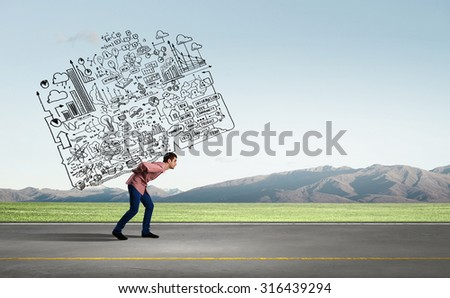 Young businessman carrying his great business plan on back