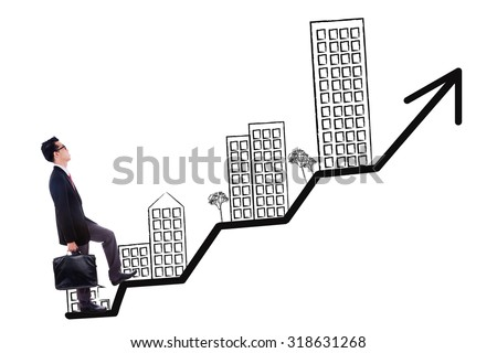 Young businessman carrying suitcase and walking on the growing real estate chart - stock photo