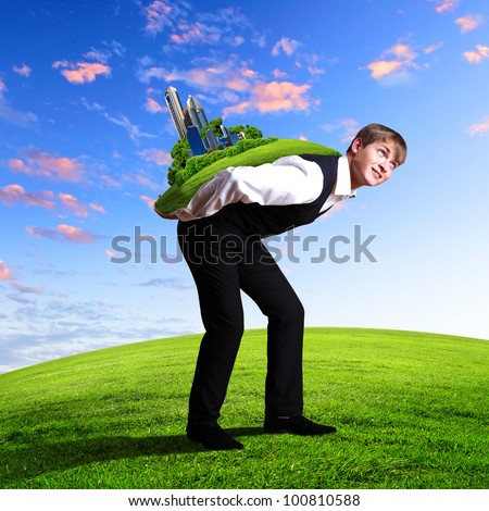Young businessman carrying world on his back - stock photo