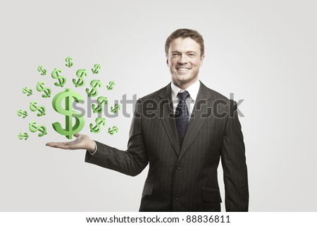 Young  businessman chooses a green US dollar signs.On a gray background - stock photo