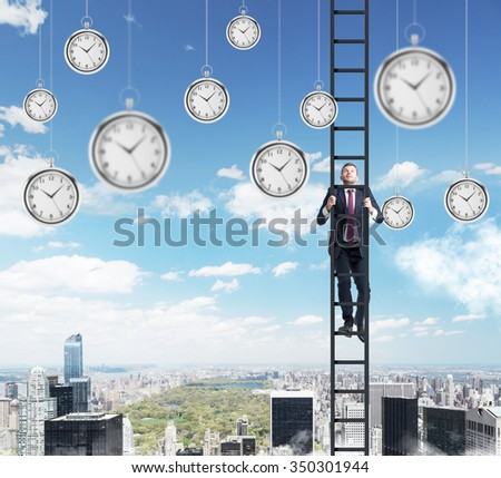 young businessman climbing a career ladder, pocket watches hovering around, in the sky. New York at the background. Concept of time is money - stock photo