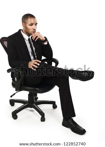 Young businessman contemplating while sitting on chair