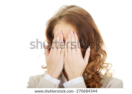 Young businessman covering face by hand. - stock photo