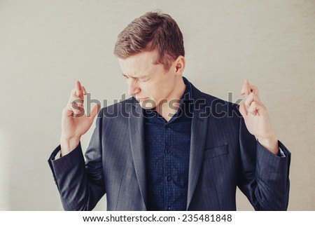 young businessman crossed finger - stock photo