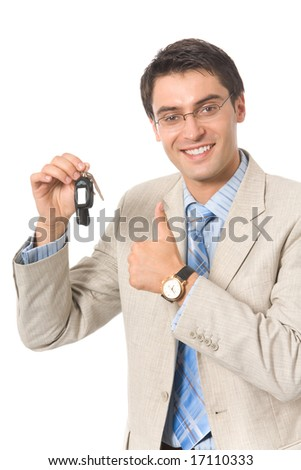 Young businessman demonstrating keys of new car, isolated on white - stock photo