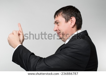 Young businessman despair pointing his finger to his head like shooting a gun