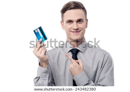Young businessman displaying his debit card