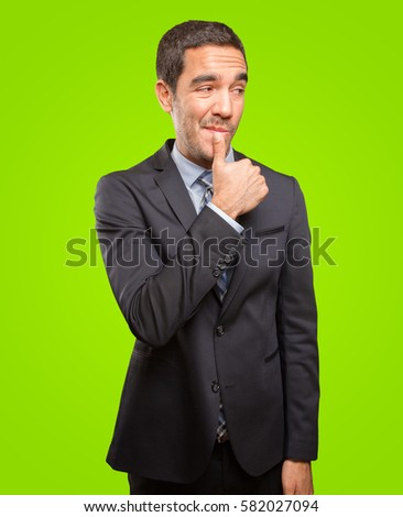 Young businessman doing a gesture of seduction