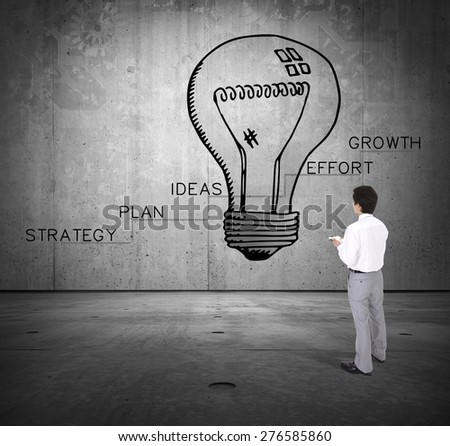 Young businessman drawing business plan. Growth concept - stock photo