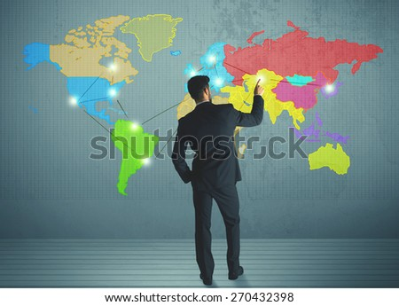 Young businessman drawing map on wall, social network concept - stock photo