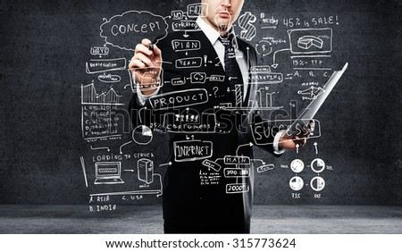 young businessman drawing plan business concept - stock photo