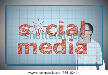 young businessman drawing social media on virtual screen - stock photo