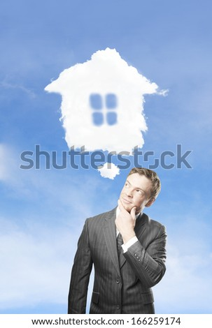 young businessman dreaming  of a new house - stock photo