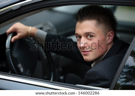 young businessman driving car