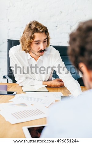 Young businessman during a meeting with others to launch start-up
