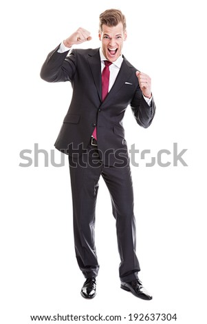 Young businessman enjoying the success - Full length portrait of a satisfied young businessman isolated on white background - stock photo