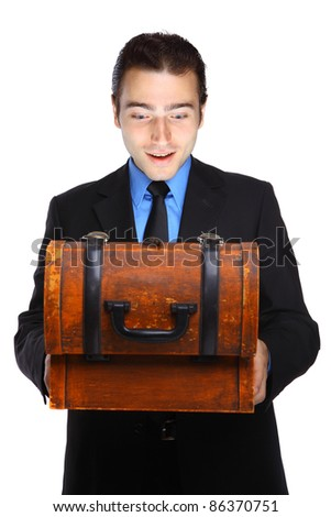 Young businessman excited about a treasure box