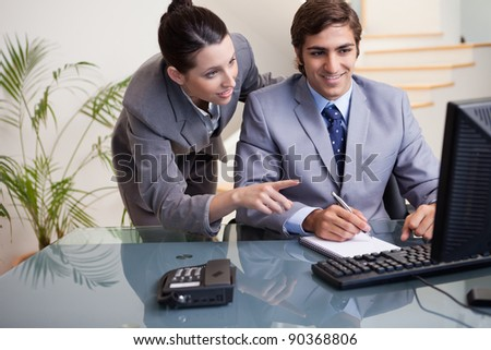 Young businessman explaining her colleague what he has to do