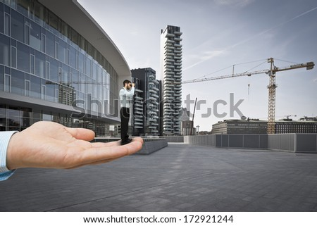 Young businessman getting help in looking for new opportunities - stock photo